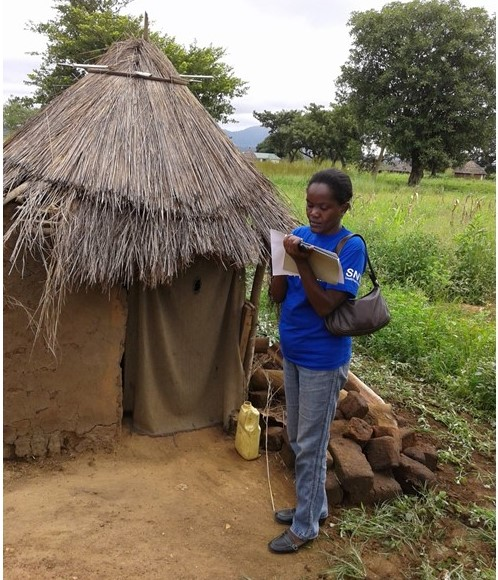 Martha Keega assesses a latrine in South Sudan