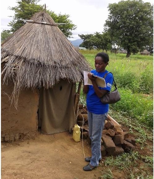 Martha Keega assesses a latrine in South Sudan